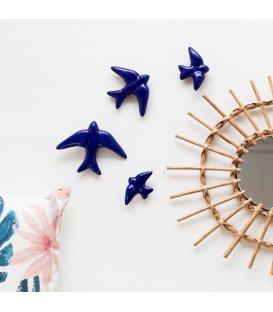 Golondrinas azul klein de cerámica esmaltadas.